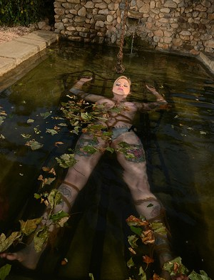 Tattooed chick Hollie Hatton is restrained and submerged in a pool of water