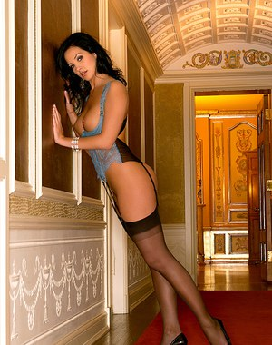 Brunette centerfold Tiffany Fallon in stockings and high heels showing hot ass
