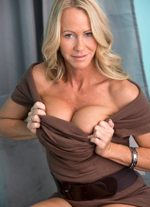 Leggy blonde MILF showing off nice ass and big tits while undressing