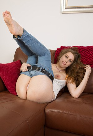 Hot MILF Krissi peels tight jeans to exhibit nice big tits  pose on her knees