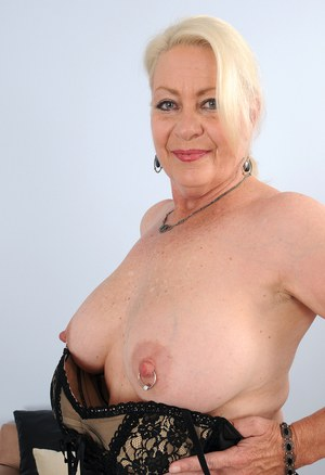 Horny mature granny Angelique in black lace lingerie showing closeup pussy