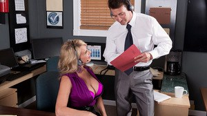 Older blonde woman Laura Layne and a coworker feel the mutual attraction
