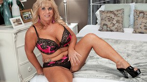 Older lady Zena Rey seduces a younger boy in a bra and panty set