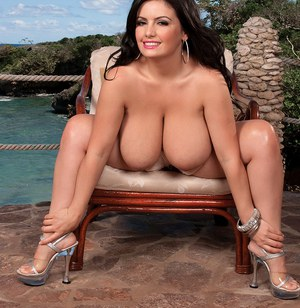 Chunky solo model Arianna Sinn sets her knockers free on a patio chair