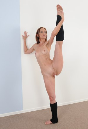 30 plus female Betty Blaze removes tutu to pose nude in leg warmers
