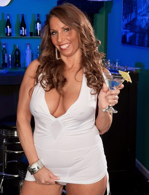 Middle-aged lady Stacie Starr rips open her dress to air out her natural tits