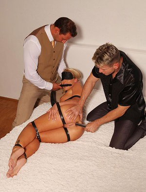 Blindfolded and restrained Kathia Nobili having ass toyed before BDSM DP