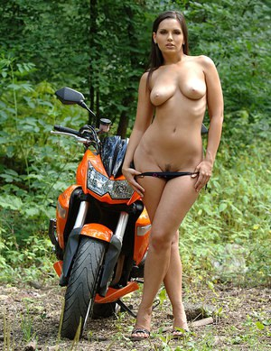 Beautiful solo girl Eve Angel hops off her bike to remove bikini in the woods