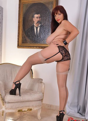 Chubby mom Joanna Bliss unveiling huge saggy tits in stockings and garters