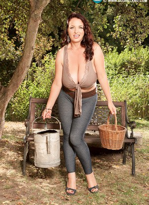 Thick solo model unleashes her massive tits on a bench in the shade