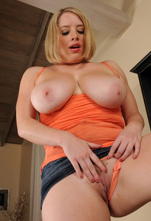 30 plus female Maggie G uncovers her large boobs before pussy play
