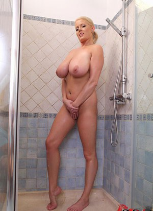 Wet blonde with piercings soaps up huge hooters and nipples in shower