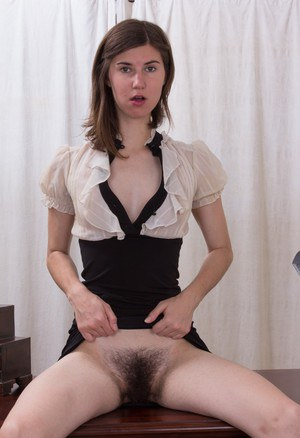 Innocent looking Kiyoko hikes her dress & drives a dildo into her hairy pussy