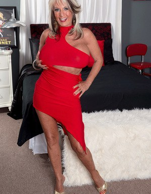 Hot granny Sally D'angelo has her big boobs loosed before riding a younger man