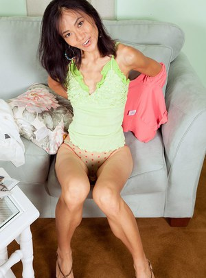 Mature Asian Sahara Blue shows off her skinny body and flat chest