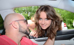 Busty brunette gets picked up by guy in a car with a large cock