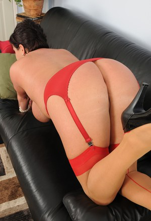 Hot chubby Angelica Sin doffs red lingerie & shows big tits & ass in stockings