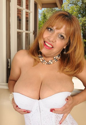 Mature Latina babe Marissa unleashes her huge boobs before parting her twat