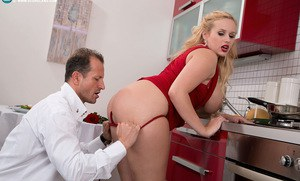 Blond chick Angel Wicky greets her guy in a short red dress in seduction scene