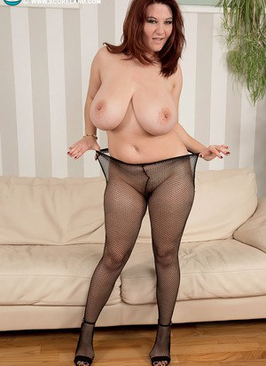 BBW Vanessa Y uncorks her hooters during a slow striptease in mesh pantyhose