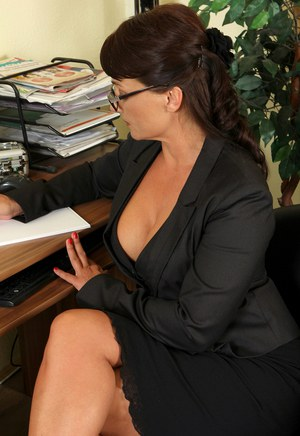 Horny mature office worker Belle P doffs her suit to bend over naked in heels
