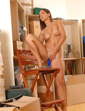 Naked MILF with nice big tits discovers vibrator in moving box  toys pussy