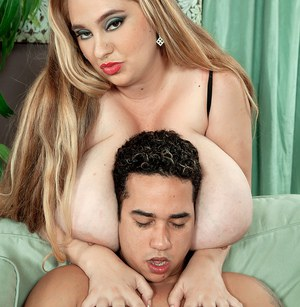 Long haired BBW April Mckenzie tit smothers a man while seducing him