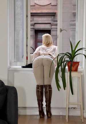 Hot blonde in jeans  boots fucking doggystyle on knees  getting cum on ass