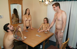 Teen girls Amber and Lexi Lee provide a handjob after losing at cards
