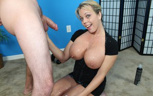Amber Lynn Bach catches jizz on her huge tits after jerking a big cock