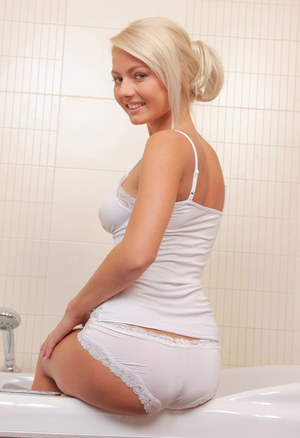 Barely legal blonde teen plays with herself while soaking in a bathtub