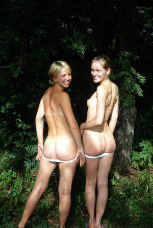 Smiles besties flash hot ass outdoors and play naked in the shower together
