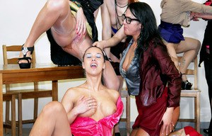 Group of clothed females take turns pissing on each other