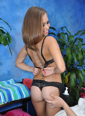 Petite 18 year old masseuse strips naked and rides her client