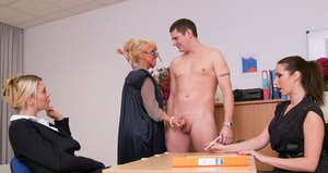 Clothed woman and her office mates jerk off a man at an office party