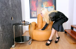 Blonde in a black dress gets soaked with sperm at a gloryhole