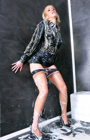 Clothed female hikes up her black miniskirt before getting drenched in jizz