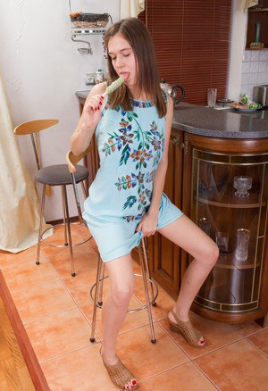 Dirty little Agneta fucks her hairy beaver with a lollipop in the kitchen