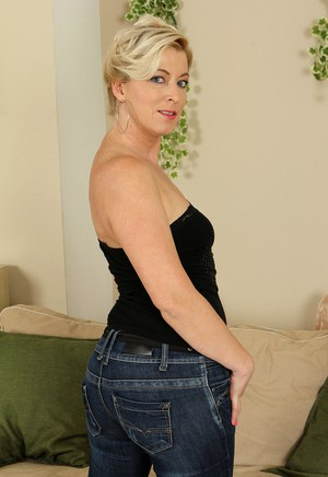 Tiny titted sexy blonde MILF Michelle H peels her jeans to spread shaved pussy