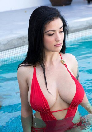 Brunette swimsuit model whips out huge tits before banging equally big dick