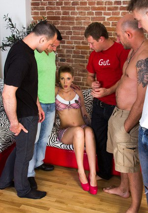 Young slut Katya Mirova takes it up the ass during her first gangbang
