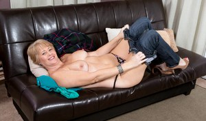 Horny amateur MILF Tracy Licks strips naked to lounge with hard nipples bared