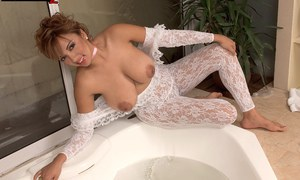Latina model Paola Rios strips off her lace bodystocking before having a bath
