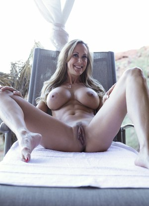 Blonde MILF loosing large tits and sex ass while stripping naked