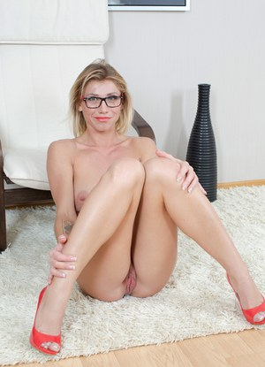 Horny housewife folds back her labia lips in the nude with glasses on her face