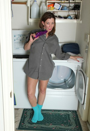 Hot wife Sally Jones spreading naked in socks on the dryer with saggy tits