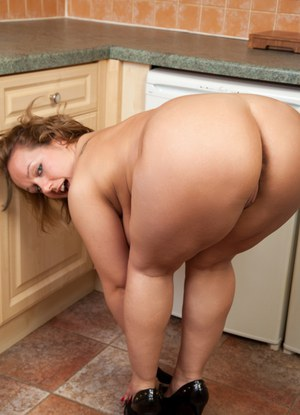 Chubby housewife exposing big MILF tits and tattoos in kitchen
