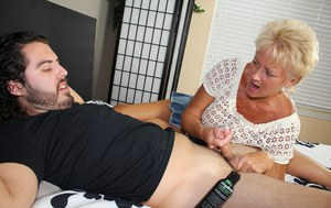 Naughty mature woman in a miniskirt jerks off her sister's son