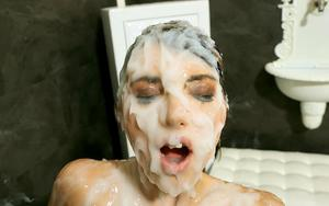Clothed women gets naked while being covered in huge amounts of jizz