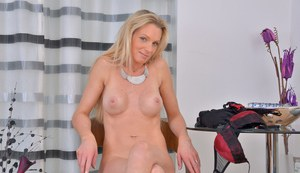 Mature MILF in stockings flashes sexy upskirt & poses naked spreading pussy
